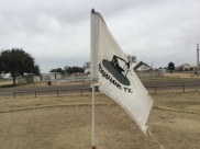 The flag shows a oil well which is really cool!