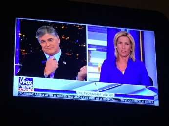 Is Sean Hannity holding an invisible gun? If true, good for him!